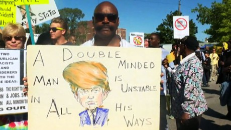 160903105945-donald-trump-protesters-outside-detroit-church-00000000-large-169